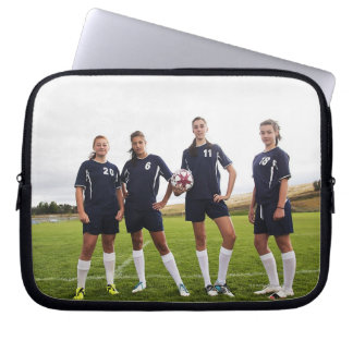 group portait of teen girl soccer players laptop sleeve