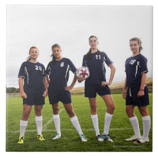 group portait of teen girl soccer players large square tile