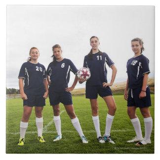 group portait of teen girl soccer players tile