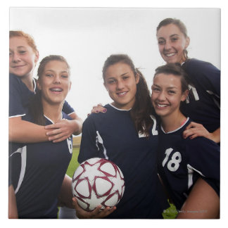 group portrait of teen girl soccer players large square tile