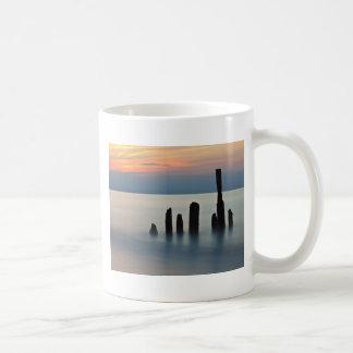 Groynes and sunset on the Baltic Sea coast Basic White Mug
