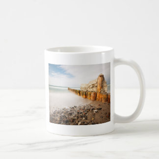 Groynes on shore of the Baltic Sea Basic White Mug