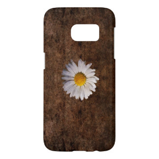 Grunge daisy on a brown background