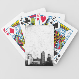 Grungy city background in black and white bicycle playing cards