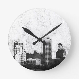 Grungy city background in black and white round clock