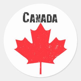 Grungy maple leaf design round sticker