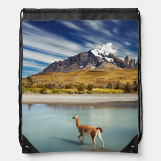 Guanaco crossing the river in Torres del Paine Drawstring Bag