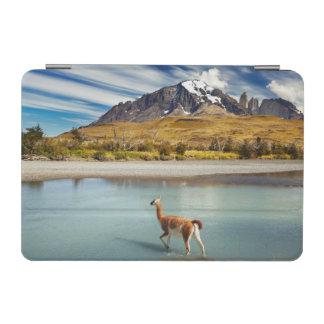Guanaco crossing the river in Torres del Paine iPad Mini Cover