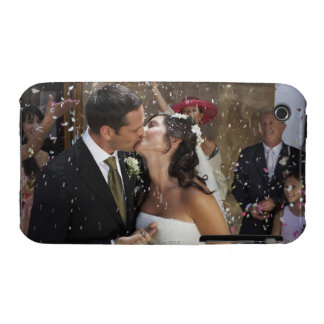 Guests throwing confetti over kissing bride and iPhone 3 covers