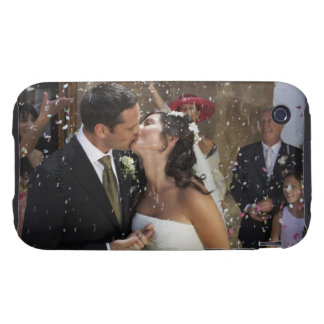 Guests throwing confetti over kissing bride and tough iPhone 3 covers