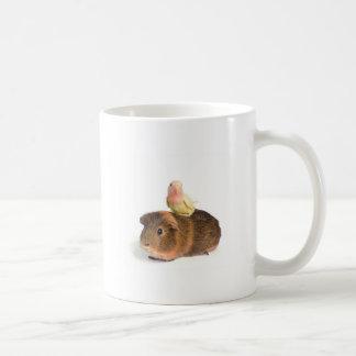 guinea pig and yellow bird coffee mugs
