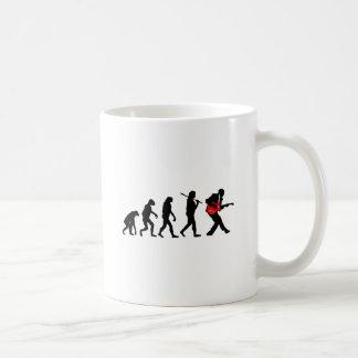 Guitar player evolution coffee mug