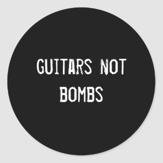 guitars not bombs round sticker