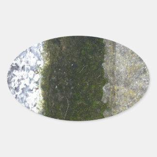 Gutter Trash -- Slime with concrete gutter. Oval Sticker