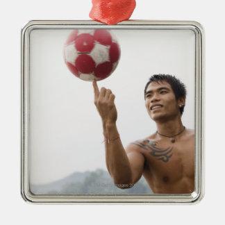 Guy spinning football on finger christmas ornament
