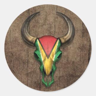 Guyana Flag Bull Skull on Wood Effect Classic Round Sticker
