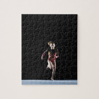 Gymnast (12-13) running on mat jigsaw puzzle