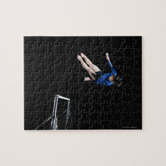 Gymnast (16-17) dismounting uneven bars jigsaw puzzle