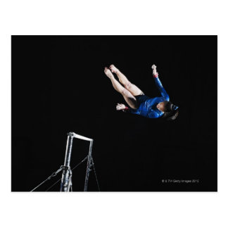 Gymnast (16-17) dismounting uneven bars postcard