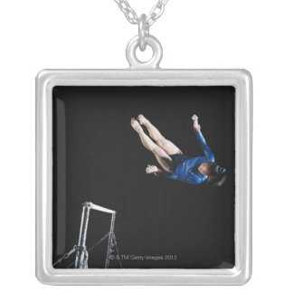 Gymnast (16-17) dismounting uneven bars silver plated necklace