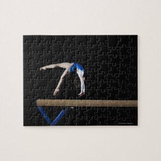 Gymnast (9-10) flipping on balance beam, side puzzles