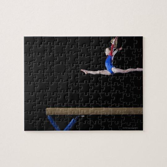 Gymnast (9-10) leaping on balance beam 2 jigsaw