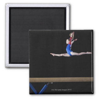 Gymnast (9-10) leaping on balance beam 2 magnet