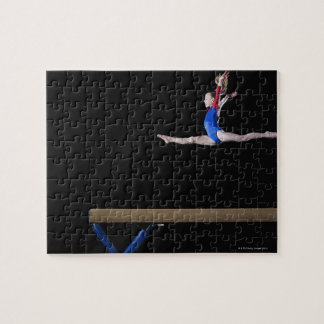 Gymnast (9-10) leaping on balance beam 2 puzzles