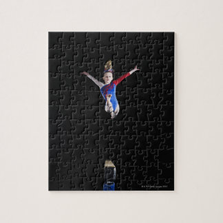 Gymnast (9-10) leaping on balance beam jigsaw puzzle