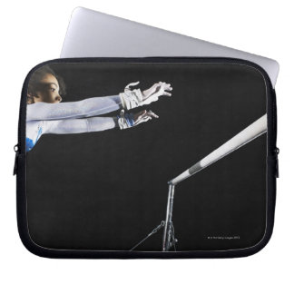 Gymnast (9-10) reaching for uneven bars 2 computer sleeves