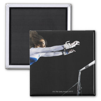 Gymnast (9-10) reaching for uneven bars 2 magnet