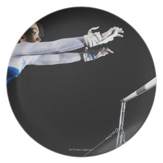 Gymnast (9-10) reaching for uneven bars 2 plates