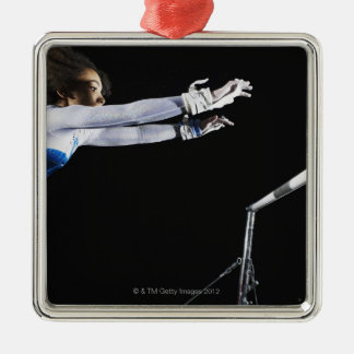 Gymnast (9-10) reaching for uneven bars 2 Silver-Colored square decoration