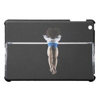 Gymnast (9-10) reaching for uneven bars iPad mini covers