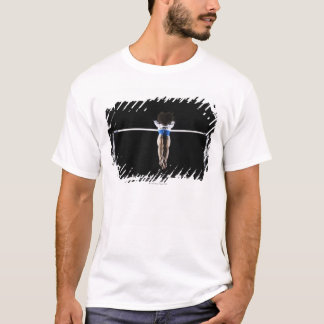 Gymnast (9-10) reaching for uneven bars T-Shirt