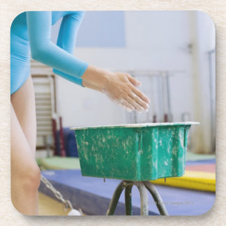 Gymnast chalking her hands coaster