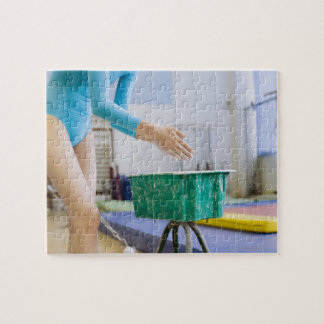 Gymnast chalking her hands puzzle