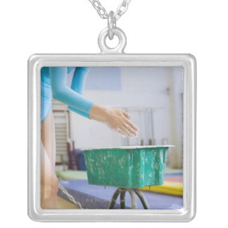 Gymnast chalking her hands silver plated necklace