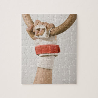 Gymnast hand holding ring puzzle