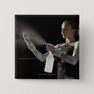 Gymnast spraying water on hands 15 cm square badge