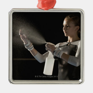 Gymnast spraying water on hands christmas ornament