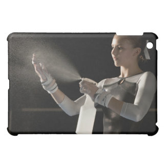 Gymnast spraying water on hands cover for the iPad mini