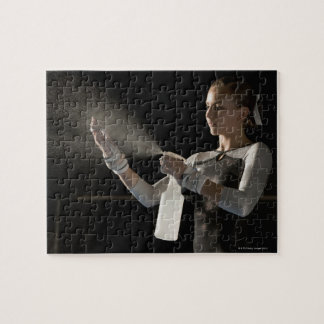 Gymnast spraying water on hands jigsaw puzzle