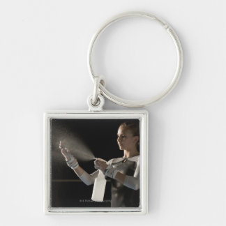 Gymnast spraying water on hands key ring