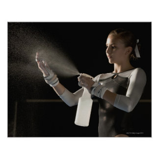 Gymnast spraying water on hands poster