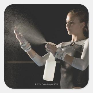 Gymnast spraying water on hands square sticker
