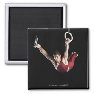 Gymnast swinging from rings magnet