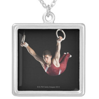 Gymnast swinging from rings silver plated necklace
