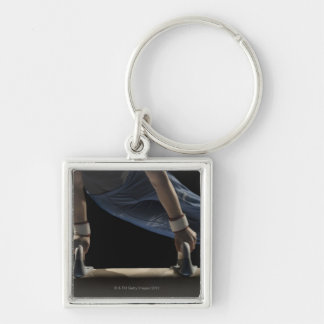 Gymnast swinging on pommel horse key ring