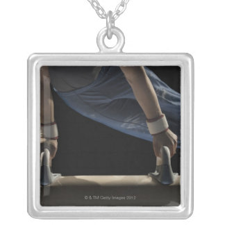Gymnast swinging on pommel horse pendants